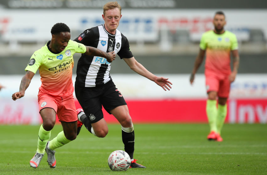Raheem Sterling of Manchester City and Sean Longstaff of Newcastle United. (Photo by Robbie Jay Barratt - AMA/Getty Images)