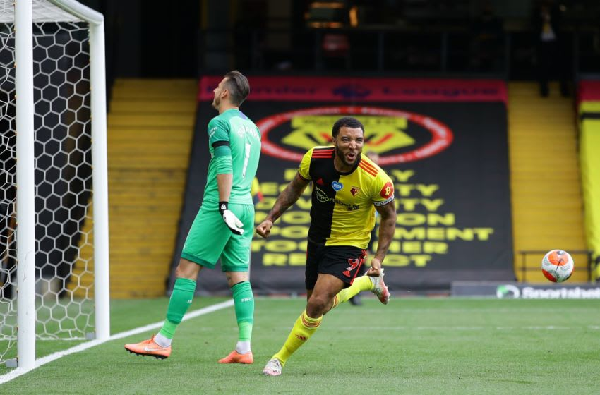 Watford's Troy Deeney celebrates after he scores. (Photo by Richard Heathcote / POOL / AFP) / RESTRICTED TO EDITORIAL USE. No use with unauthorized audio, video, data, fixture lists, club/league logos or 'live' services. Online in-match use limited to 120 images. An additional 40 images may be used in extra time. No video emulation. Social media in-match use limited to 120 images. An additional 40 images may be used in extra time. No use in betting publications, games or single club/league/player publications. / (Photo by RICHARD HEATHCOTE/POOL/AFP via Getty Images)