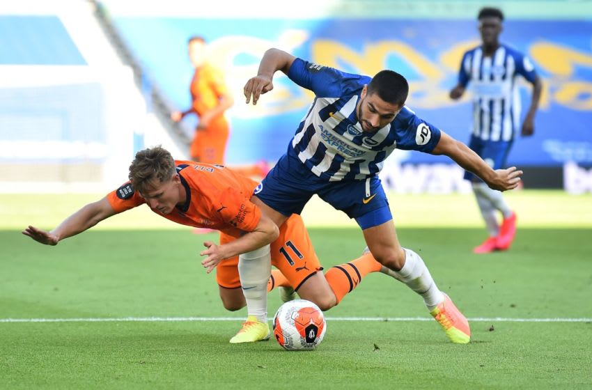Newcastle United's Matt Ritchie (L) vies for the ball against Brighton's French striker Neal Maupay (R) (Photo by Glyn KIRK / POOL / AFP)