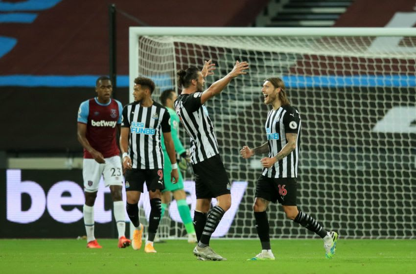 Newcastle United's Andy Carroll (C) reacts after Jeff Hendrick (R) scored their second goal. (Photo by ADAM DAVY/POOL/AFP via Getty Images)