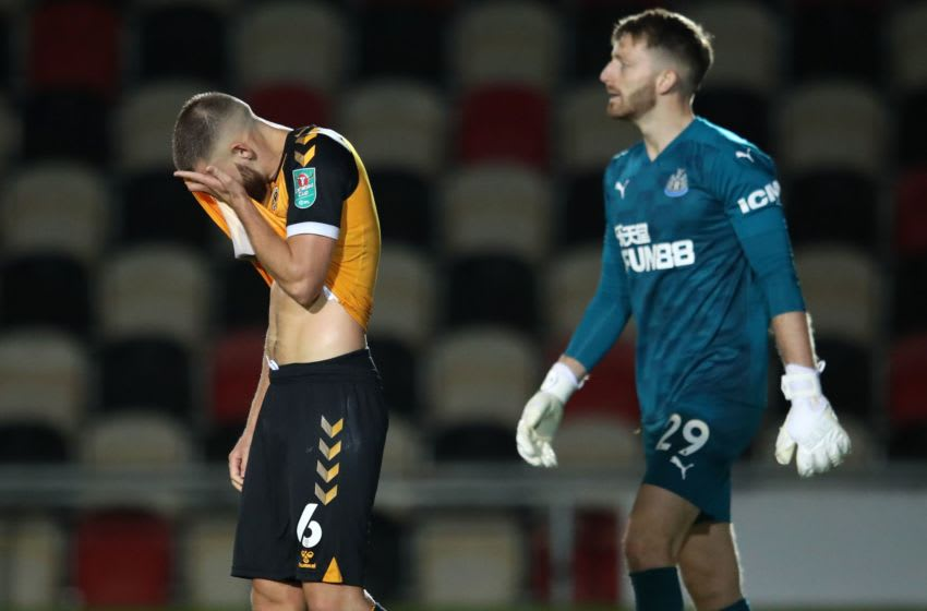 Newport County's Brandon Cooper reacts after missing. (Photo by ALEX PANTLING/POOL/AFP via Getty Images)