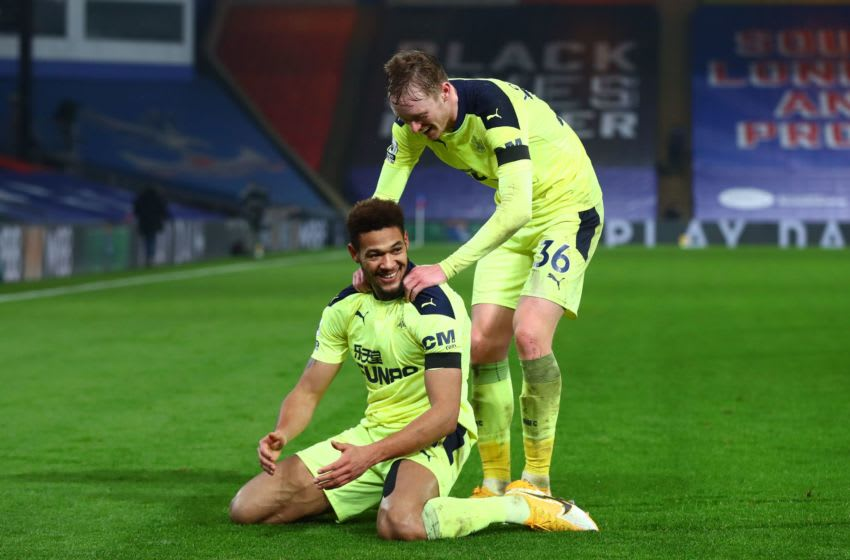 Newcastle United's Joelinton (L) celebrates with Sean Longstaff (R). (Photo by CLIVE ROSE/POOL/AFP via Getty Images)