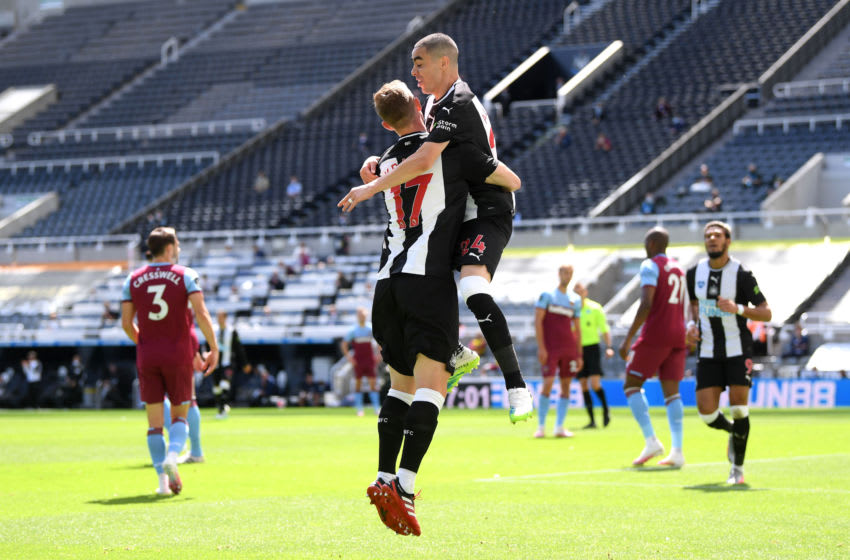 Miguel Almiron of Newcastle United celebrates with teammate Emil Krafth of Newcastle United. (Photo by Laurence Griffiths/Getty Images)