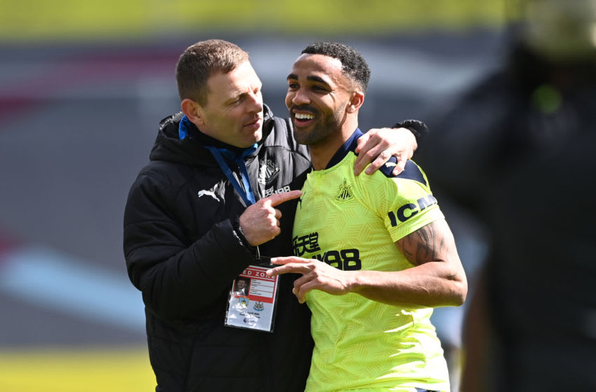 Callum Wilson of Newcastle shares a joke with assistant coach Graeme Jones. (Photo by Stu Forster/Getty Images)