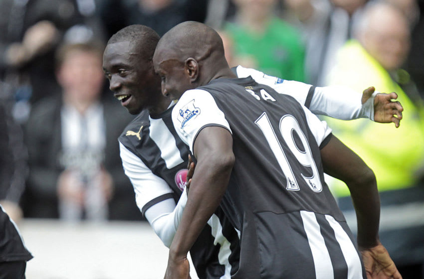 """Newcastle United's Senegalese striker Papiss Cisse (L) celebrates scoring their second goal with Senegalese striker Demba Ba (R) during the English Premier League football match between Newcastle United and Stoke City at Sports Direct Arena in Newcastle, north-east England on April 21, 2012. AFP PHOTO/GRAHAM STUART RESTRICTED TO EDITORIAL USE. No use with unauthorized audio, video, data, fixture lists, club/league logos or """"live"""" services. Online in-match use limited to 45 images, no video emulation. No use in betting, games or single club/league/player publications (Photo credit should read GRAHAM STUART/AFP via Getty Images)"""
