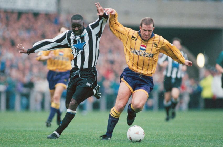 Newcastle forward Andy Cole (L) battles with Peter Atherton during the FA Premiership match between Newcastle United and Sheffield Wednesday at St James' Park on October 22, 1994, in Newcastle, England. (Photo by Chris Cole/Allsport UK/Getty Images)