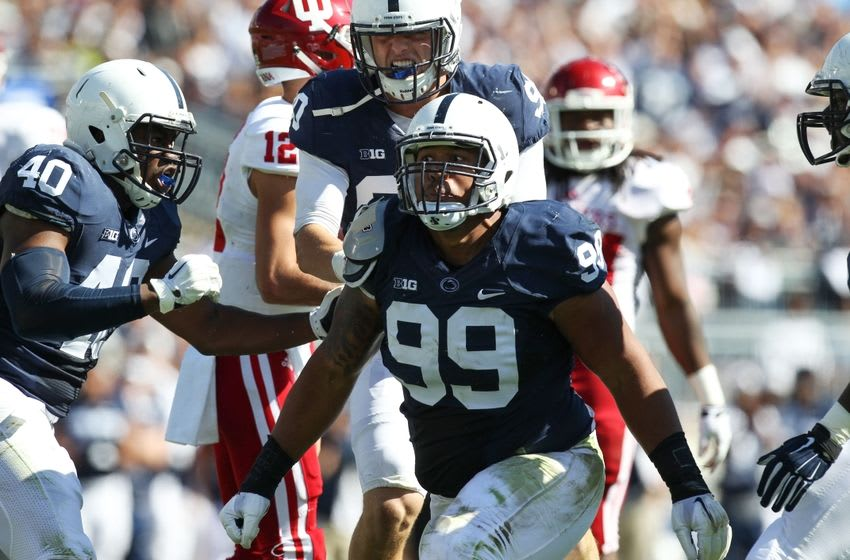 Oct 10, 2015; University Park, PA, USA; Penn State Nittany Lions defensive tackle Austin Johnson (99) reacts after sacking Indiana Hoosiers quarterback Zander Diamont (not pictured) during the second quarter at Beaver Stadium. Mandatory Credit: Matthew O