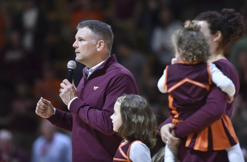 Dec 1, 2015; Blacksburg, VA, USA; The new Virginia Tech Hokies head football coach Justin Fuente (L) speaks to the fans during halftime against the Northwestern Wildcats at Cassell Coliseum. The Wildcats won 81-79. Mandatory Credit: Michael Shroyer-USA TODAY Sports