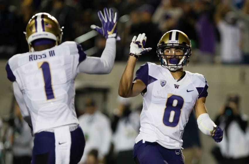 Nov 5, 2016; Berkeley, CA, USA; Washington Huskies wide receiver John Ross (1) celebrates with wide receiver Dante Pettis (8) after a touchdown against the California Golden Bears during the first quarter at Memorial Stadium. Mandatory Credit: Kelley L Cox-USA TODAY Sports