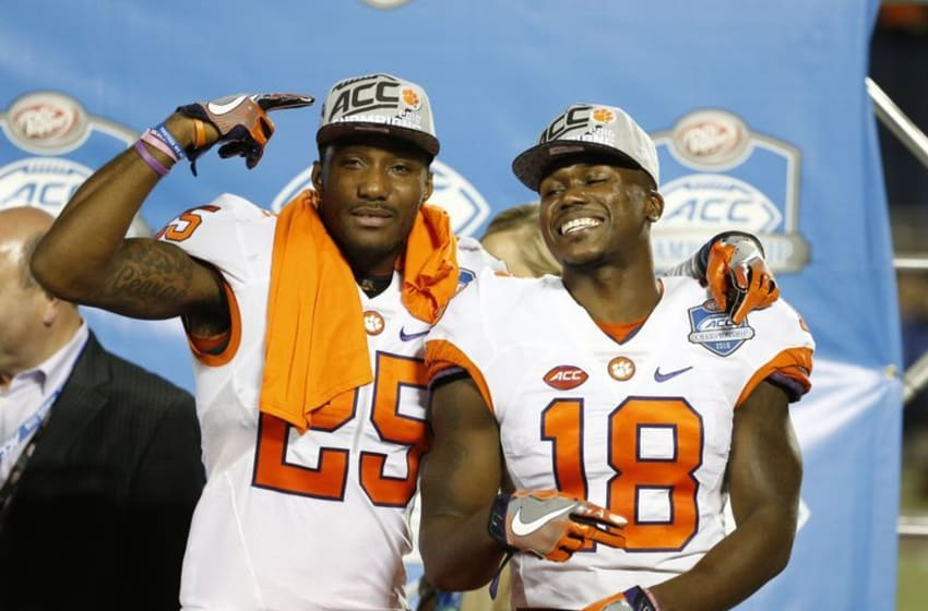 Dec 3, 2016; Orlando, FL, USA; Clemson Tigers cornerback Cordrea Tankersley (25) and safety Jadar Johnson (18) celebrate after they beat the Virginia Tech Hokies of the ACC Championship college football game at Camping World Stadium. Clemson Tigers defeated the Virginia Tech Hokies 42-35. Mandatory Credit: Kim Klement-USA TODAY Sports