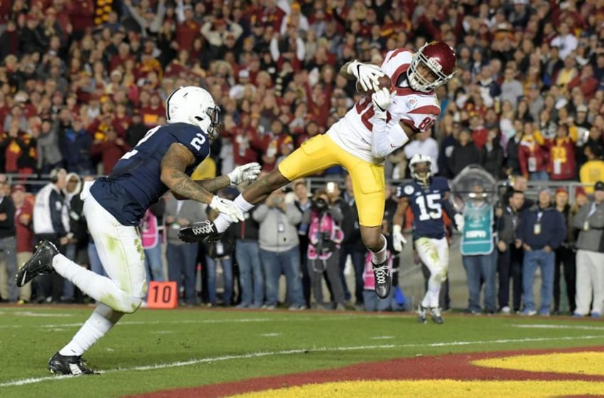 Jan 2, 2017; Pasadena, CA, USA; USC Trojans wide receiver Deontay Burnett (80) catches a pass for a touchdown against Penn State Nittany Lions safety Marcus Allen (2) during the fourth quarter of the 2017 Rose Bowl game at Rose Bowl. Mandatory Credit: Kirby Lee-USA TODAY Sports