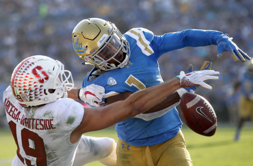 PASADENA, CA - NOVEMBER 24: Darnay Holmes #1 of the UCLA Bruins breaks up a pass intended for JJ Arcega-Whiteside #19 of the Stanford Cardinal during the second half of a game at the Rose Bowl on November 24, 2018 in Pasadena, California. (Photo by Sean M. Haffey/Getty Images)