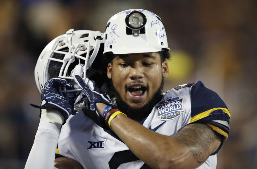 ORLANDO, FL - DECEMBER 28: Kenny Robinson Jr. #2 of the West Virginia Mountaineers celebrates on the sideline after intercepting a pass in the first quarter of the Camping World Bowl against the Syracuse Orange at Camping World Stadium on December 28, 2018 in Orlando, Florida. (Photo by Joe Robbins/Getty Images)