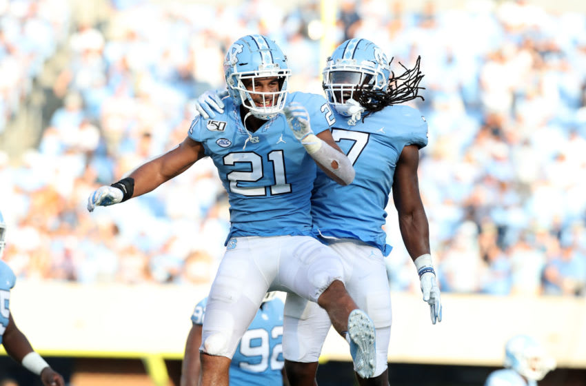 CHAPEL HILL, NC - SEPTEMBER 28: Chazz Surratt #21 and Jonathan Smith #7 of the University of North Carolina celebrate on the sideline during a game between Clemson University and University of North Carolina at Kenan Memorial Stadium on September 28, 2019 in Chapel Hill, North Carolina. (Photo by Andy Mead/ISI Photos/Getty Images)
