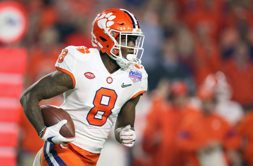 GLENDALE, ARIZONA - DECEMBER 28: Justyn Ross #8 of the Clemson Tigers carries the ball against the Ohio State Buckeyes in the first half during the College Football Playoff Semifinal at the PlayStation Fiesta Bowl at State Farm Stadium on December 28, 2019 in Glendale, Arizona. (Photo by Christian Petersen/Getty Images)