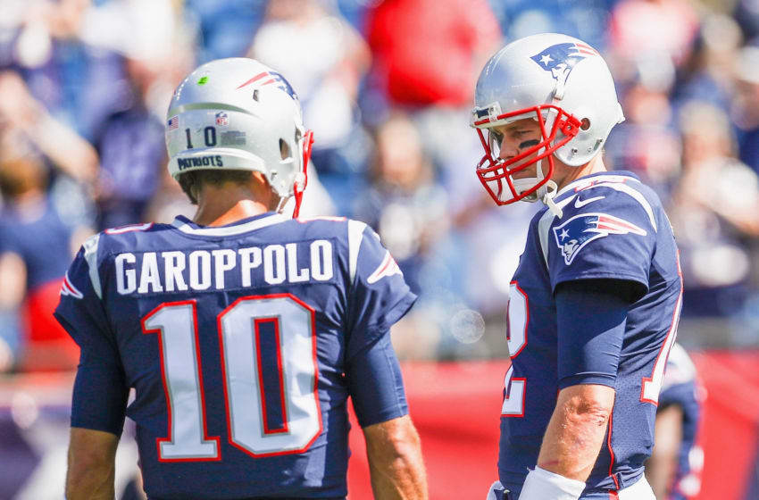 FOXBORO, MASSACHUSETTS - SEPTEMBER 24: Tom Brady #12 of the New England Patriots talks with Jimmy Garoppolo #10 before a game against the Houston Texans at Gillette Stadium on September 24, 2017 in Foxboro, Massachusetts. (Photo by Maddie Meyer/Getty Images)