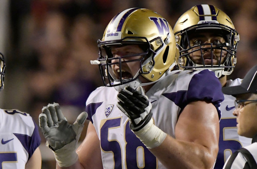 SALT LAKE CITY, UT - SEPTEMBER 15: Kaleb McGary #58 of the Washington Huskies celebrates a touchdown awarded after a review in the second half of a game against the Utah Utes at Rice-Eccles Stadium on September 15, 2018 in Salt Lake City, Utah. The Washington Huskies beat the Utah Utes 21-7. (Photo by Gene Sweeney Jr/Getty Images)