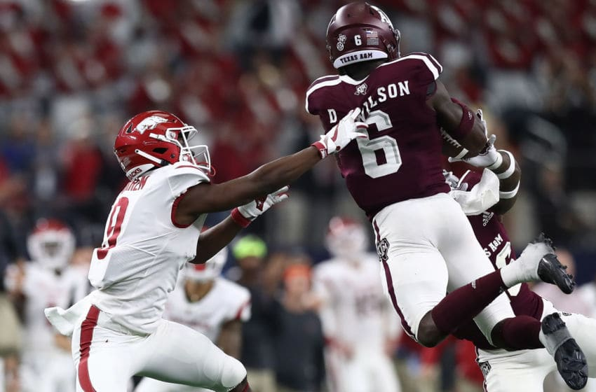 ARLINGTON, TX - SEPTEMBER 29: Donovan Wilson #6 of the Texas A&M Aggies makes a pass interception intended for De'Vion Warren #9 of the Arkansas Razorbacks during Southwest Classic at AT&T Stadium on September 29, 2018 in Arlington, Texas. (Photo by Ronald Martinez/Getty Images)