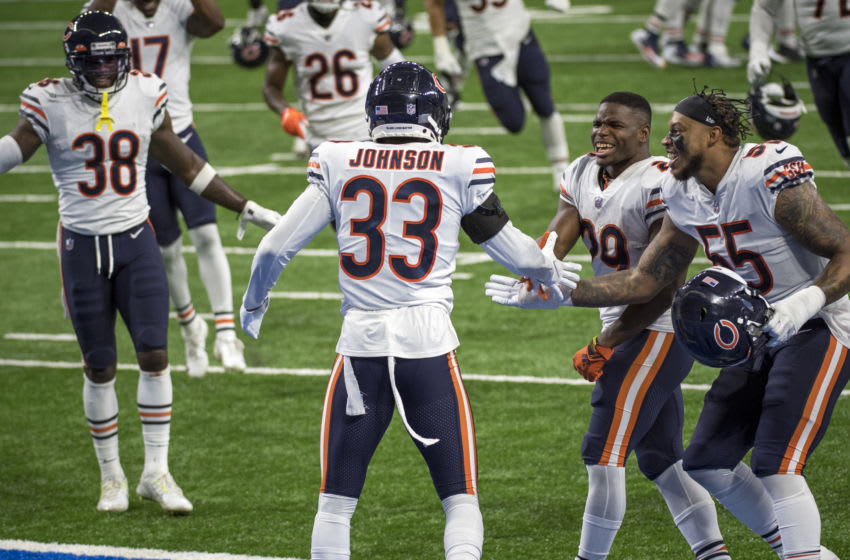 DETROIT, MI - SEPTEMBER 13: From left, Tashaun Gipson #38 of the Chicago Bears, Jaylon Johnson #33 of the Chicago Bears, Tarik Cohen #29 of the Chicago Bears, Josh Woods #55 of the Chicago Bears celebrate winning the game against the Detroit Lions at Ford Field on September 13, 2020 in Detroit, Michigan. (Photo by Nic Antaya/Getty Images)