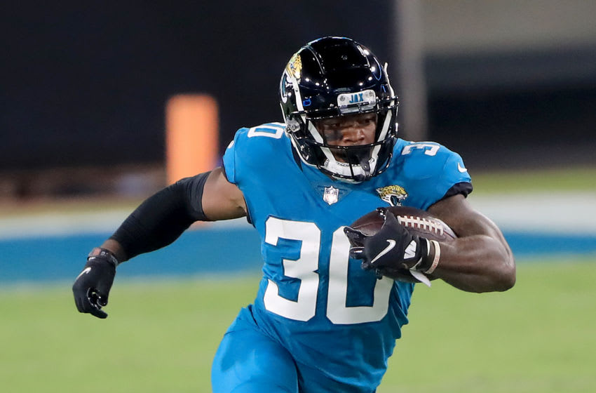 JACKSONVILLE, FLORIDA - SEPTEMBER 24: James Robinson #30 of the Jacksonville Jaguars runs for yardage during the game against the Miami Dolphins at TIAA Bank Field on September 24, 2020 in Jacksonville, Florida. (Photo by Sam Greenwood/Getty Images)