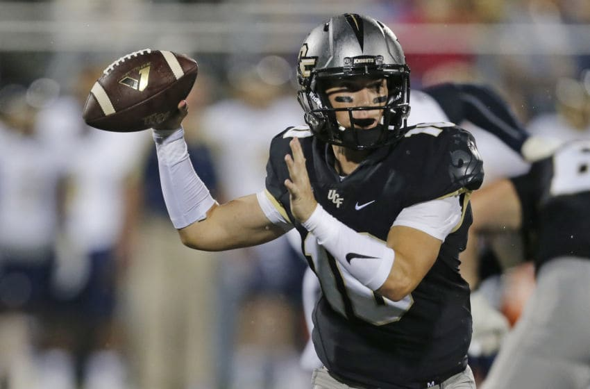 MIAMI, FL - SEPTEMBER 24: Mckenzie Milton #10 of the Central Florida Knights throws the ball against the Florida International Golden Panthers during first quarter action on September 24, 2016 at FIU Stadium in Miami, Florida. (Photo by Joel Auerbach/Getty Images)