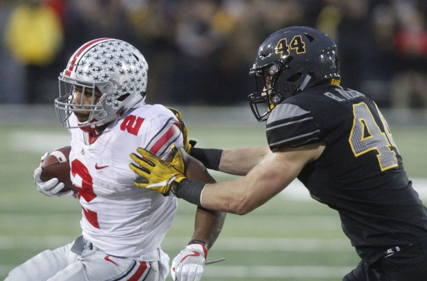 IOWA CITY, IOWA- NOVEMBER 04: Running back J.K. Dobbins #2 of the Ohio State Buckeyes is taken out of bounds in the fourth quarter by linebacker Ben Niemann #44 of the Iowa Hawkeyes, on November 04, 2017 at Kinnick Stadium in Iowa City, Iowa. (Photo by Matthew Holst/Getty Images)