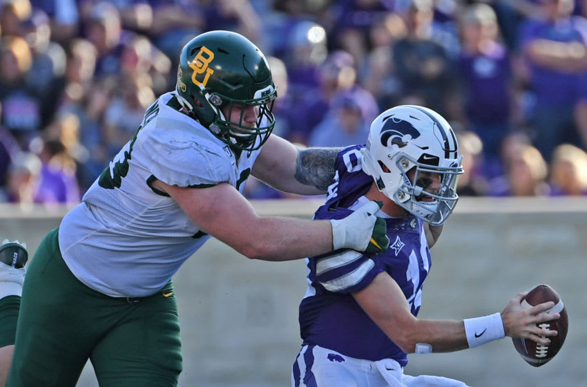 MANHATTAN, KS - OCTOBER 05: Defensive tackle James Lynch #93 of the Baylor Bears sacks quarterback Skylar Thompson #10 of the Kansas State Wildcats during the second half at Bill Snyder Family Football Stadium on October 5, 2019 in Manhattan, Kansas. (Photo by Peter G. Aiken/Getty Images)