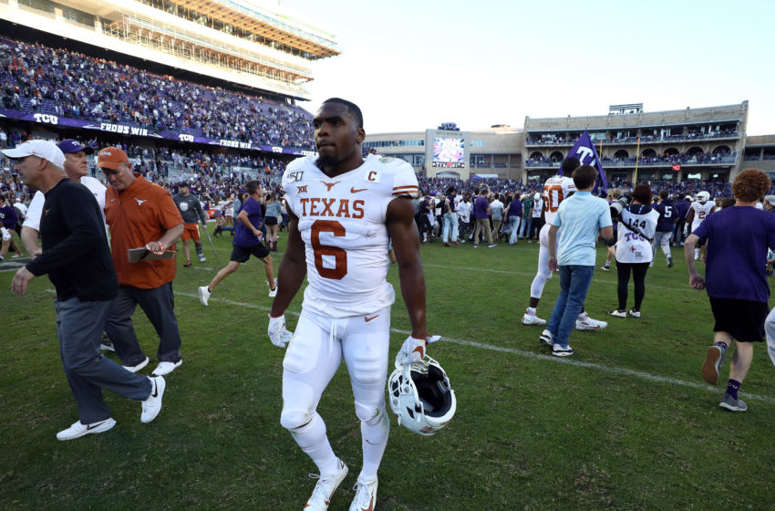 FORT WORTH, TEXAS - OCTOBER 26: Devin Duvernay #6 of the Texas Longhorns walks off as fans rush onto the field after the TCU Horned Frogs defeated the Longhorns 37-27 at Amon G. Carter Stadium on October 26, 2019 in Fort Worth, Texas. (Photo by Ronald Martinez/Getty Images)