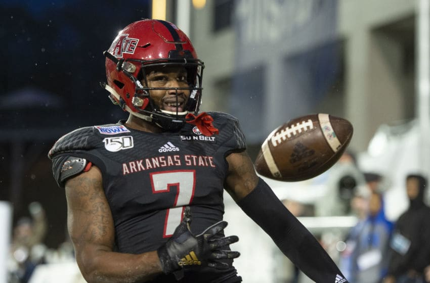 MONTGOMERY, AL - DECEMBER 21: Wide receiver Omar Bayless #7 of the Arkansas State Red Wolves celebrates after scoring a touchdown during the first quarter of their game against the FIU Golden Panthers in the Camellia Bowl at the Crampton Bowl on December 21, 2019 in Montgomery, Alabama. (Photo by Michael Chang/Getty Images)