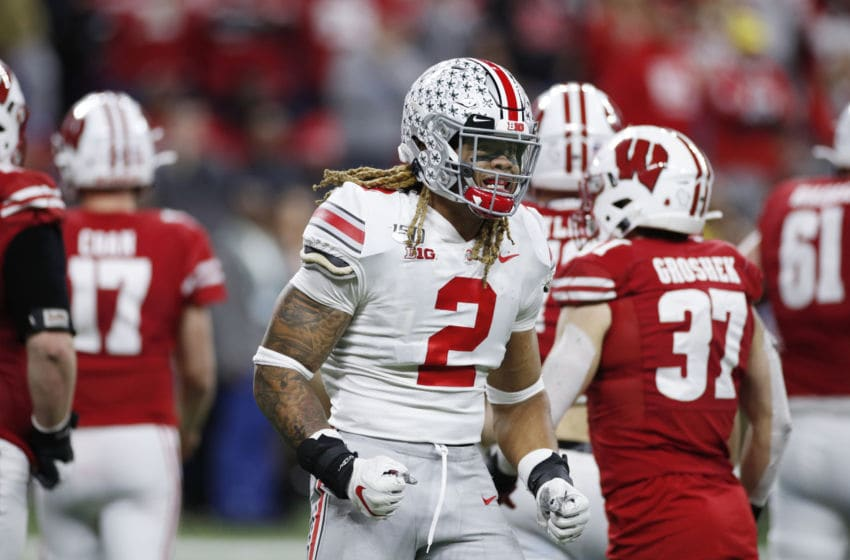 INDIANAPOLIS, IN - DECEMBER 07: Chase Young #2 of the Ohio State Buckeyes celebrates in the fourth quarter against the Wisconsin Badgers during the Big Ten Football Championship at Lucas Oil Stadium on December 7, 2019 in Indianapolis, Indiana. Ohio State defeated Wisconsin 34-21. (Photo by Joe Robbins/Getty Images)