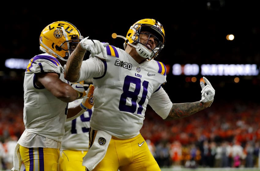 NEW ORLEANS, LOUISIANA - JANUARY 13: Thaddeus Moss #81 of the LSU Tigers celebrates after scoring a touchdown against the Clemson Tigers during the third quarter in the College Football Playoff National Championship game at Mercedes Benz Superdome on January 13, 2020 in New Orleans, Louisiana. (Photo by Jonathan Bachman/Getty Images)