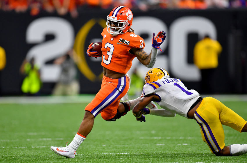 NEW ORLEANS, LOUISIANA - JANUARY 13: Amari Rodgers #3 of the Clemson Tigers breaks Kristian Fulton #1 of the LSU Tigers tackle during the second quarter of the College Football Playoff National Championship game at the Mercedes Benz Superdome on January 13, 2020 in New Orleans, Louisiana. The LSU Tigers topped the Clemson Tigers, 42-25. (Photo by Alika Jenner/Getty Images)