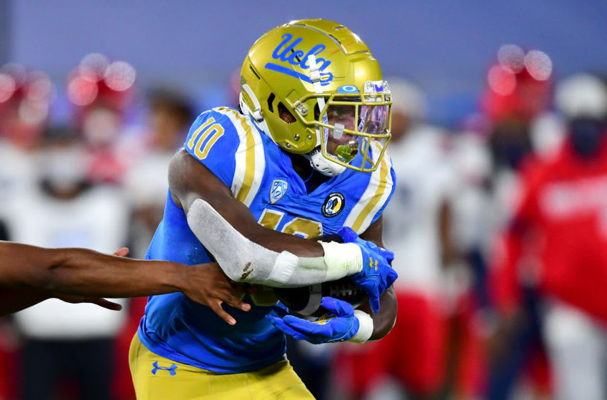 PASADENA, CA - NOVEMBER 28: Running back Demetric Felton #10 of the UCLA Bruins carries the ball for a gain in the game against the Arizona Wildcats at the Rose Bowl on November 28, 2020 in Pasadena, California. (Photo by Jayne Kamin-Oncea/Getty Images)