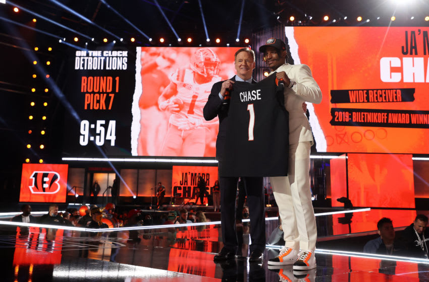 CLEVELAND, OHIO - APRIL 29: Ja'Marr Chase poses with NFL Commissioner Roger Goodell onstage after being selected fifth by the Cincinnati Bengals during round one of the 2021 NFL Draft at the Great Lakes Science Center on April 29, 2021 in Cleveland, Ohio. (Photo by Gregory Shamus/Getty Images)
