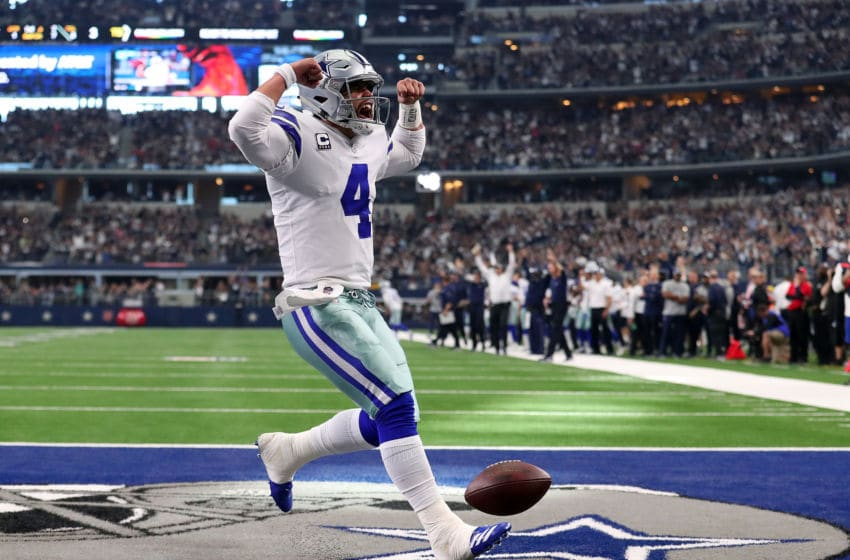 ARLINGTON, TEXAS - DECEMBER 23: Dak Prescott #4 of the Dallas Cowboys celebrates a touchdown in the first quarter of a football game against the Tampa Bay Buccaneers at AT&T Stadium on December 23, 2018 in Arlington, Texas. (Photo by Tom Pennington/Getty Images)