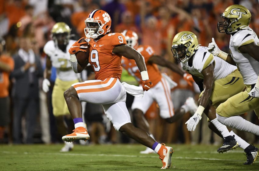 CLEMSON, SOUTH CAROLINA - AUGUST 29: Running back Travis Etienne #9 of the Clemson Tigers rushes for a touchdown during the second quarter of the Tigers' football game against the Georgia Tech Yellow Jackets at Memorial Stadium on August 29, 2019 in Clemson, South Carolina. (Photo by Mike Comer/Getty Images)