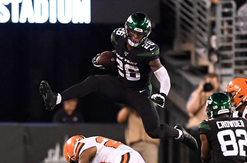 New York Jets running back Le?Veon Bell (26) hurdles over Cleveland Browns safety Eric Murray (22) in the second half. The New York Jets lose to the Cleveland Browns, 23-3, in NFL Week 2 on Monday, Sept. 16, 2019, in East Rutherford. Nyj Vs Cle Week 2