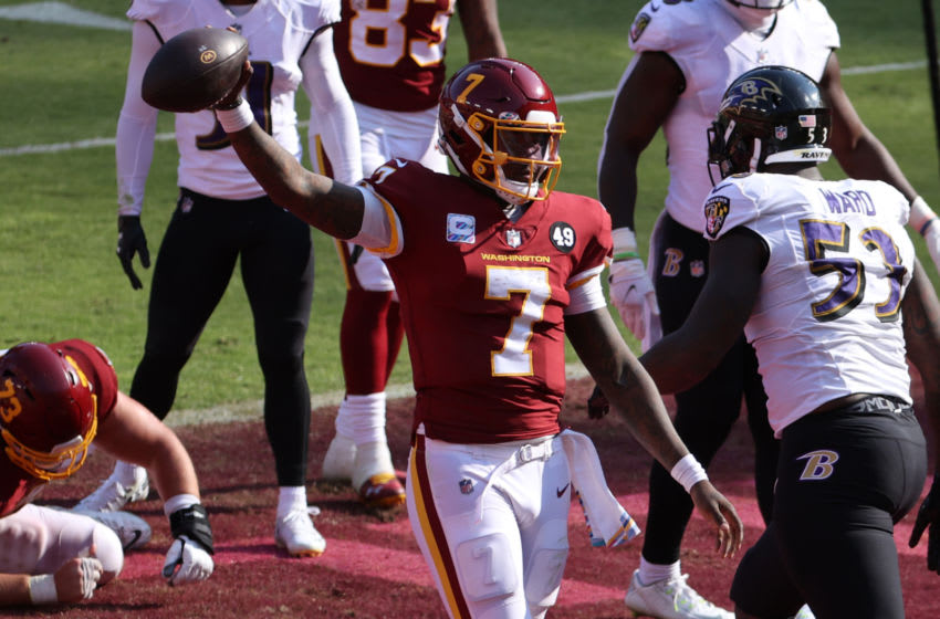 Oct 4, 2020; Landover, Maryland, USA; Washington Football Team quarterback Dwayne Haskins (7) celebrates after scoring a touchdown against the Baltimore Ravens in the fourth quarter at FedExField. Mandatory Credit: Geoff Burke-USA TODAY Sports