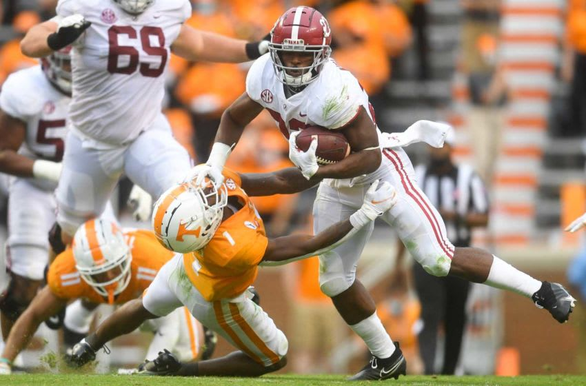 Alabama running back Najee Harris (22) pushes back Tennessee defensive back Trevon Flowers (1) in the second half during a game between Alabama and Tennessee at Neyland Stadium in Knoxville, Tenn. on Saturday, Oct. 24, 2020. 102420 Ut Bama Gameaction