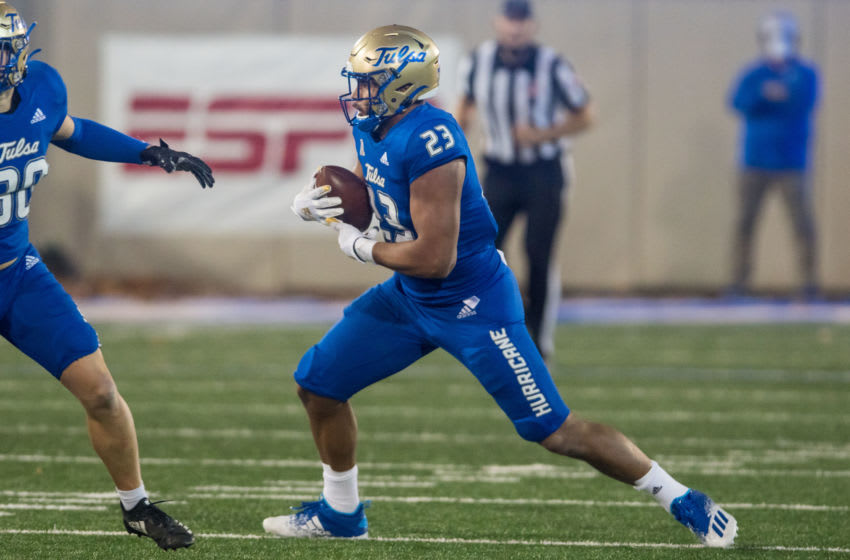 Nov 14, 2020; Tulsa, Oklahoma, USA; Tulsa Golden Hurricane linebacker Zaven Collins (23) intercepts a pass late in the fourth quarter in the game against Southern Methodist Mustangs at Skelly Field at H.A. Chapman Stadium. TU won the game 28-24. Mandatory Credit: Brett Rojo-USA TODAY Sports