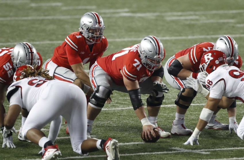 Ohio State Buckeyes offensive lineman Josh Myers (71) snaps the ball to quarterback Justin Fields (1) during the third quarter of the NCAA football game at Ohio Stadium in Columbus, Ohio on Saturday, Nov. 7, 2020. Ohio State won 49-27. Ohio State Buckeyes Football Faces The Rutgers Scarlet Knights