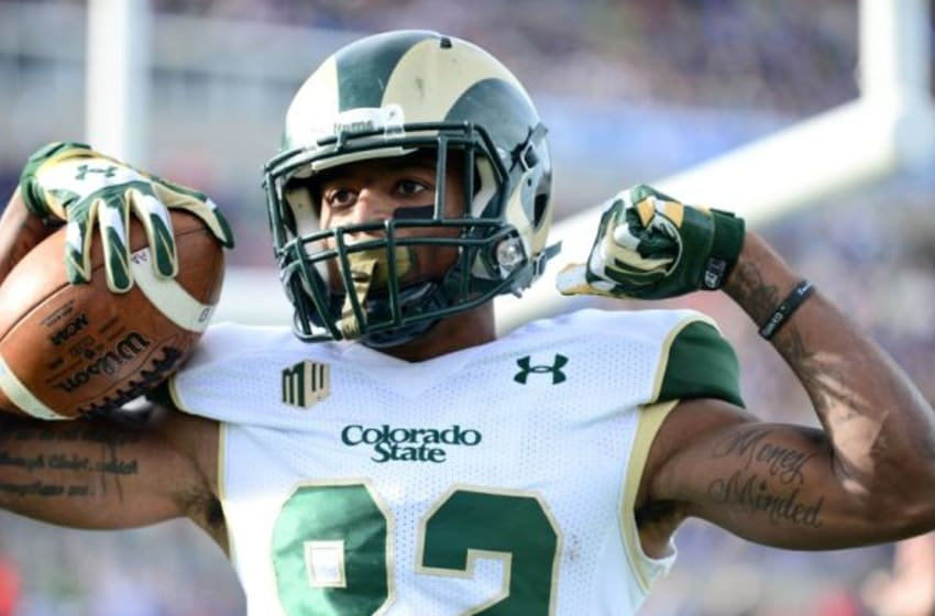 Nov 28, 2014; Colorado Springs, CO, USA; Colorado State Rams wide receiver Rashard Higgins (82) celebrates his touchdown reception in the first quarter against the Air Force Falcons at Falcon Stadium. Mandatory Credit: Ron Chenoy-USA TODAY Sports