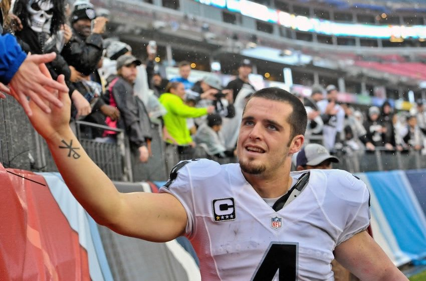 Nov 29, 2015; Nashville, TN, USA; Oakland Raiders quarterback Derek Carr (4) greets fans as he leaves the field after his team defeated the Tennessee Titans during the second half at Nissan Stadium. Oakland won 24-21. Mandatory Credit: Jim Brown-USA TODAY Sports