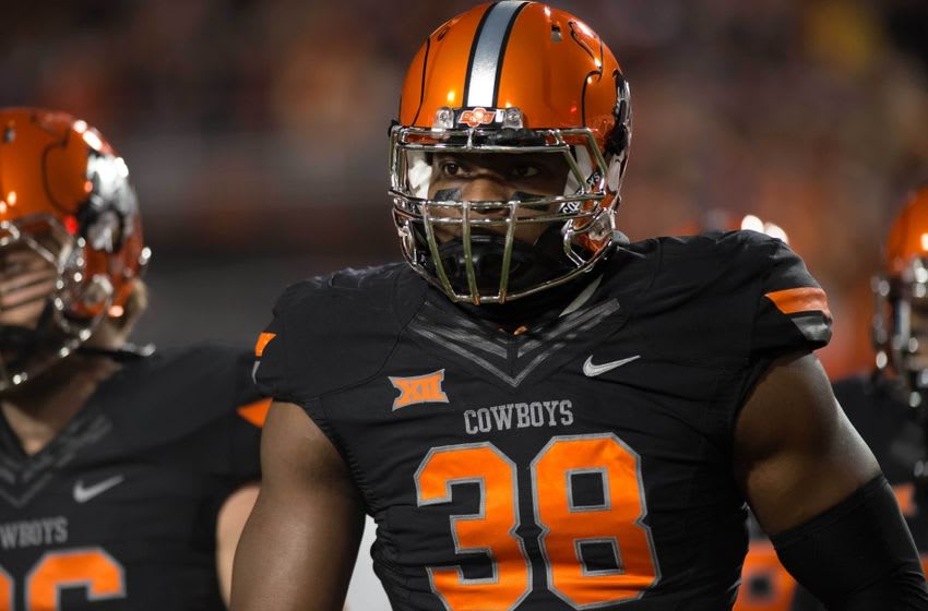 Nov 21, 2015; Stillwater, OK, USA; Oklahoma State Cowboys defensive end Emmanuel Ogbah (38) reacts during the game against the Baylor Bears at Boone Pickens Stadium. Mandatory Credit: Rob Ferguson-USA TODAY Sports