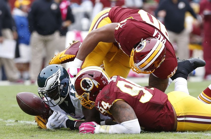 Oct 4, 2015; Landover, MD, USA; Washington Redskins defensive end Stephen Paea (90), Philadelphia Eagles wide receiver Nelson Agholor (17), and Redskins linebacker Preston Smith (94) attempt to recover an Eagles fumble in the second quarter at FedEx Field. Mandatory Credit: Geoff Burke-USA TODAY Sports