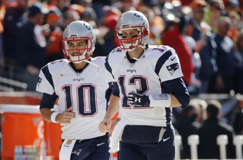 Jan 24, 2016; Denver, CO, USA; New England Patriots quarterback Tom Brady (12) and quarterback Jimmy Garoppolo (10) take the field before the AFC Championship football game against the Denver Broncos at Sports Authority Field at Mile High. Mandatory Credit: Kevin Jairaj-USA TODAY Sports
