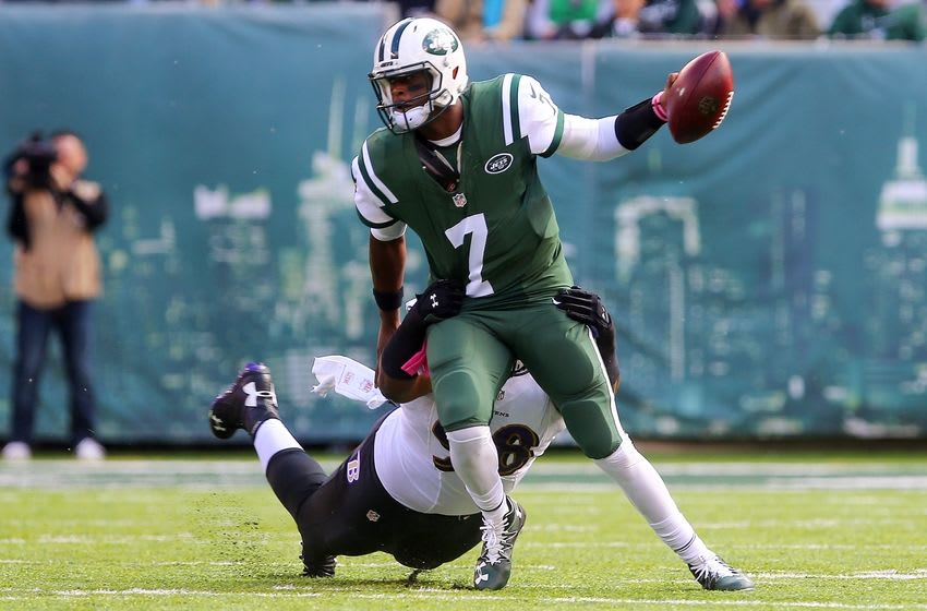 Oct 23, 2016; East Rutherford, NJ, USA; New York Jets quarterback Geno Smith (7) is tackled by Baltimore Ravens nose tackle Brandon Williams (98) during the first half at MetLife Stadium. Mandatory Credit: Ed Mulholland-USA TODAY Sports