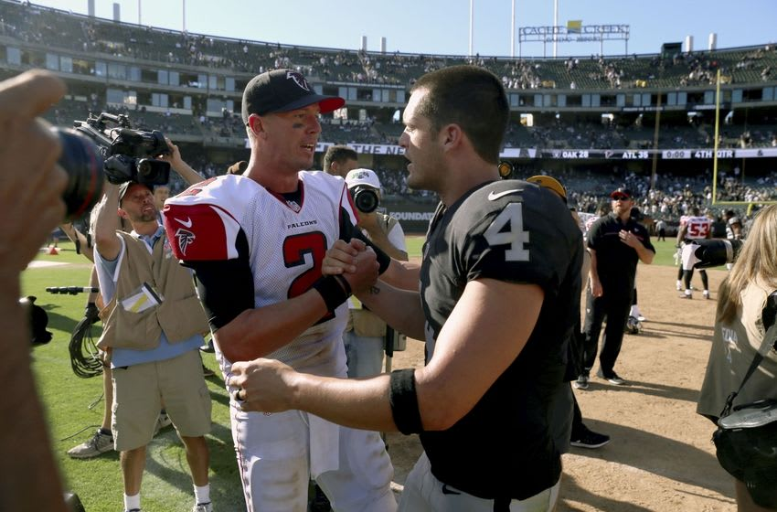 Sep 18, 2016; Oakland, CA, USA; Atlanta Falcons quarterback Matt Ryan (2) meets with Oakland Raiders quarterback Derek Carr (4) after the game at Oakland-Alameda County Coliseum. The Falcons defeated the Raiders 35-28. Mandatory Credit: Cary Edmondson-USA TODAY Sports