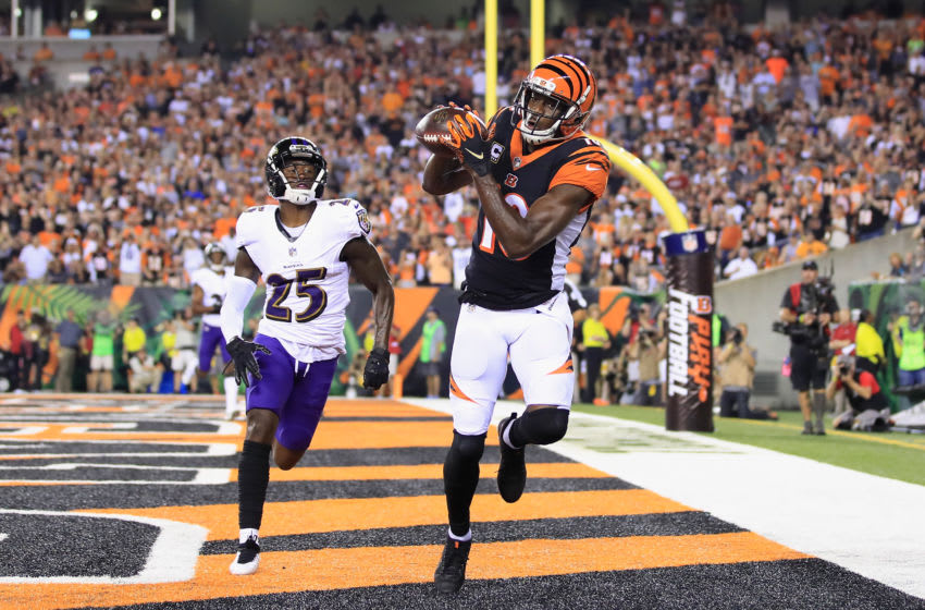 CINCINNATI, OH - SEPTEMBER 13: A.J. Green #18 of the Cincinnati Bengals scores a touchdown against Tavon Young #25 of the Baltimore Ravens during the first quarter at Paul Brown Stadium on September 13, 2018 in Cincinnati, Ohio. (Photo by Andy Lyons/Getty Images)