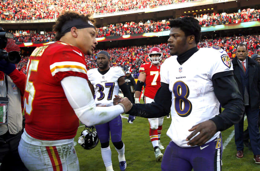 KANSAS CITY, MISSOURI - DECEMBER 09: Quarterback Patrick Mahomes #15 of the Kansas City Chiefs shakes hands with quarterback Lamar Jackson #8 of the Baltimore Ravens after the Chiefs defeated the Ravens 27-24 in overtime to win the game at Arrowhead Stadium on December 09, 2018 in Kansas City, Missouri. (Photo by Jamie Squire/Getty Images)